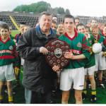 Donie Fleming, E.K.B. Bord na Nog Chairman Presenting The 2003 U14 Div 2 Trophy To Kilcummin Capt, David Brosnan.